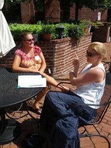 Teachers outside working at the Teacher Art Retreat.