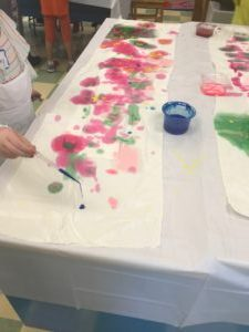 students paint wish flags
